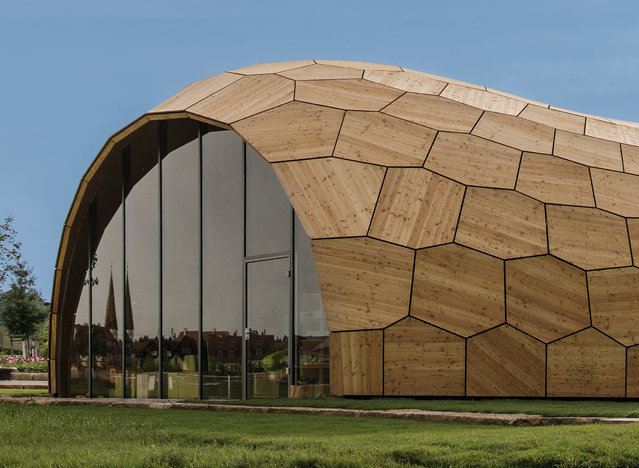 Landesgarten exhibition hall, Schwäbisch Gmünd, Germany, by University of Stuttgart. A structure built by a computer – the work of designers at the University of Stuttgart's institutes for computational design, building structures, structural design and engineering geodesy. Resembling a peanut shell, it is comprised of 243 digitally cut plywood panels. Offcuts from the job were used to make the building's parquet flooring. (Photo by ICD/ITKE/IIGS at the University of Stuttgart/The Guardian)