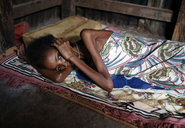 An internally displaced Muslim woman who lost her six days old baby yesterday, lies in a house in the town of Boda April 15, 2014. (Photo by Goran Tomasevic/Reuters)