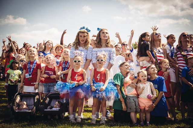 Twins line up for the annual group photo at the Twins Days Festival at Glenn Chamberlin Park on August 3, 2019 in Twinsburg, Ohio. Twins Day celebrates biological twins and has been held every summer since 1976. (Photo by Josie Gealer/Getty Images)