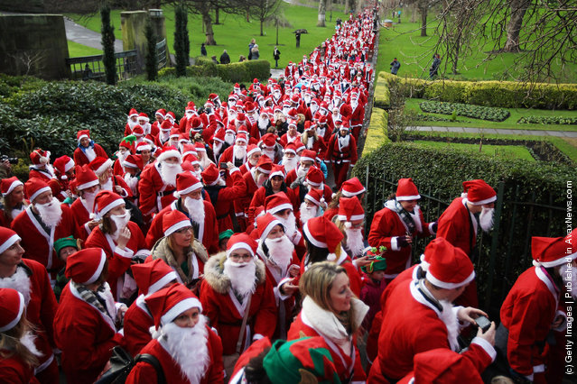 Participants dressed as Santa Claus take part in the Great Edinburgh Santa Run on December 11, 2011 in Edinburgh, Scotland