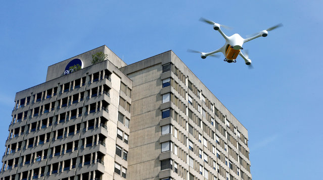 A Matternet M2 drone of U.S. manufacturer Matternet carrying a box containing laboratory samples flies during a presentation of Swiss Post and the Ticino EOC hospital group in front of the Ospedale Civico hospital in Lugano, Switzerland, March 31, 2017. (Photo by Arnd Wiegmann/Reuters)