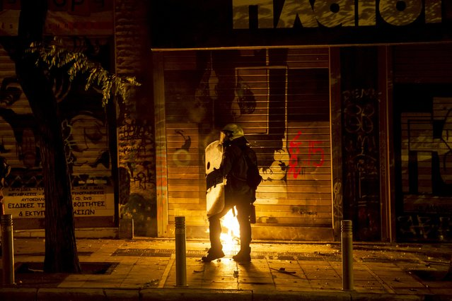"""Riot police stands along a street during minor clashes in central Athens, Greece July 6, 2015. Greeks voted overwhelmingly """"No"""" on Sunday in a historic bailout referendum, partial results showed, defying warnings from across Europe that rejecting new austerity terms for fresh financial aid would set their country on a path out of the euro. (Photo by Marko Djurica/Reuters)"""