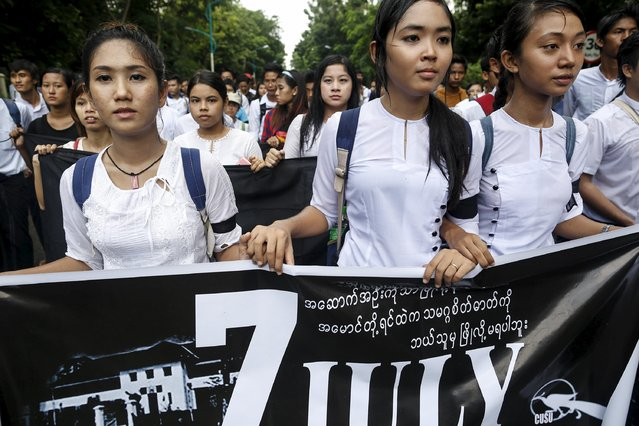 Demonstrators attend a protest led by students at Yangon University in Myanmar July 7, 2015. The students gathered in Yangon on Tuesday to mark the 53rd anniversary of the military's suppression of student protests in 1962, the same year when late General Ne Win seized power to usher in 49 years of authoritarian army rule in the former Burma. Dozens of students were killed when Ne Win's four-month-old junta crushed the 1962 demonstrations and used dynamite to blow up the students' union building of Yangon University. (Photo by Soe Zeya Tun/Reuters)
