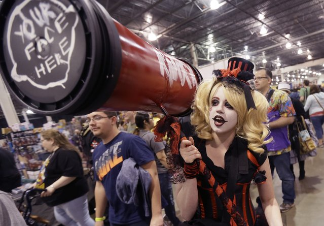 "Jordan Davis, who came dressed as ""Batman"" villain Harley Quinn, said she was stopped 15 times to pose for pictures within the first 20 minutes of the Motor City Comic Con, Friday, May 13, 2016 in Novi, Mich. Tens of thousands of fans are expected at the 27th annual convention which got underway Friday. The three-day pop-culture extravaganza welcomes dozens of celebrities from TV and film as well as hundreds of comic book creators, writers and artists. (Photo by Carlos Osorio/AP Photo)"