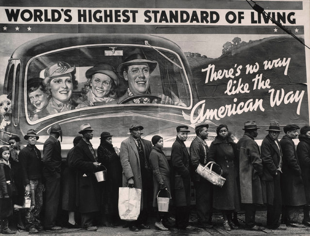 "In 1937, Margaret Bourke-White photographed an advertisement that read: ""World's highest standard of living: There's no way like the American way"". It was seen in Louisville, shortly after a flooding in Ohio River valley. A group of African Americans lined up outside, waiting for emergency relief from a government station. Bourke-White, who showed how strenuous the depression was in the 1930s, is featured in a new group exhibit that details how America coped in dire political and economic times. (Photo by Margaret Bourke-White/The Guardian)"