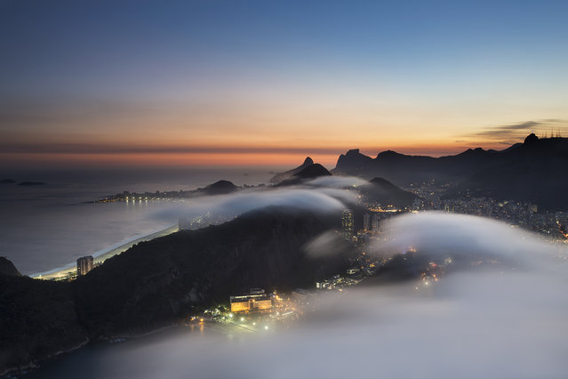 """Far above the clouds"". Rio de Janeiro viewed from above the clouds on Sugar Loaf Mountain. Photo location: Rio de Janeiro, Brazil. (Photo and caption by Tony Burns/National Geographic Photo Contest)"