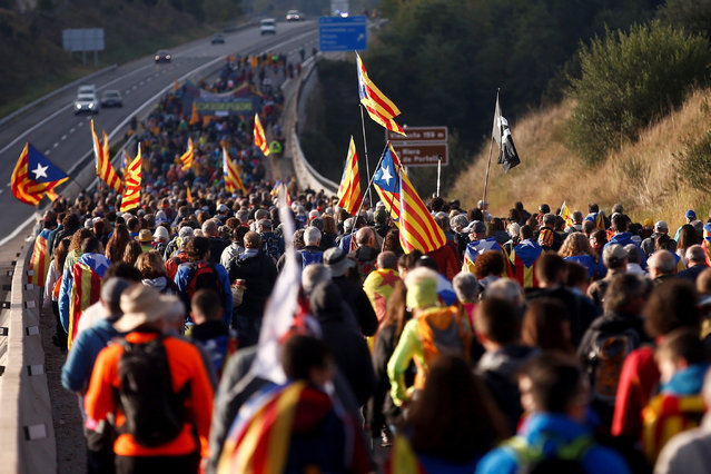 """Some hundred Catalan pro-independence supporters attend a protest march from the town to Berga to Barcelona against the Spanish Supreme Court's sentences to pro-independence leaders, released last 14 October, in Catalonia, northeastern Spain, 16 October 2019. Some protest marches called """"Marches for Freedom"""" are running from the five Catalan cities of Girona, Vic, Berga, Tarrega and Tarragona to arrive to Barcelona next 18 October. (Photo by Quique Garcia/EPA/EFE)"""