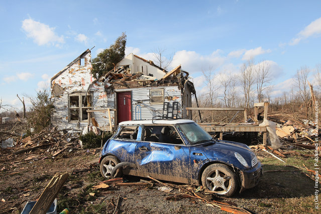 Debris from Friday's EF4 tornado remains scattered around a home March 4, 2012 in Henryville, Indiana