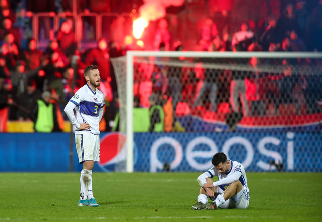 Fidan Aliti (L) of Kosovo  shows his dejection after the UEFA EURO 2020 qualifier soccer match between Czech Republic and Kosovo in Plzen, Czech Republic, 14 November 2019. (Photo by Martin Divisek/EPA/EFE)