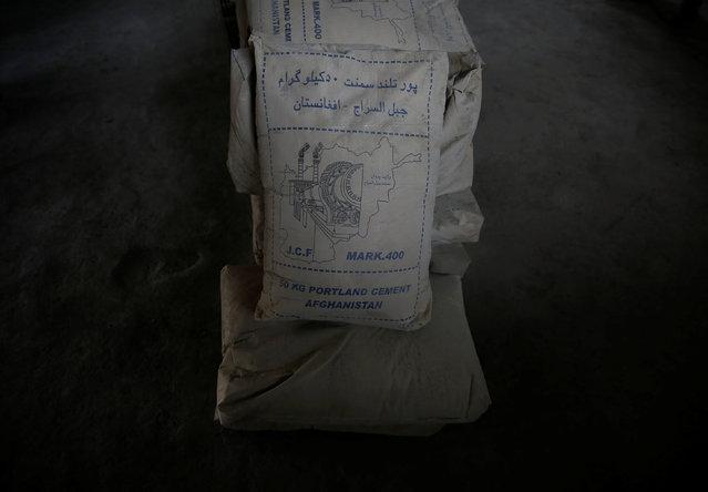 Sacks of cement lay at the Jabal Saraj cement factory in Jabal Saraj, north of Kabul, Afghanistan April 19, 2016. (Photo by Ahmad Masood/Reuters)