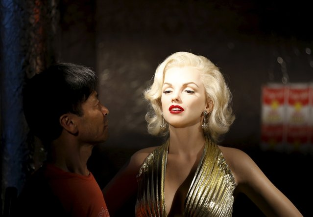 A man looks at the wax figure of Marilyn Monroe at Grevin Wax Museum in central Seoul, South Korea, July 30, 2015. (Photo by Kim Hong-Ji/Reuters)