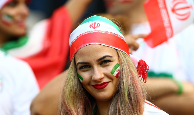 Fans of Iran during the 2014 FIFA World Cup Brazil Group F match between Iran and Nigeria at Arena da Baixada on June 16, 2014 in Curitiba, Brazil. (Photo by Amin Mohammad Jamali/Getty Images)