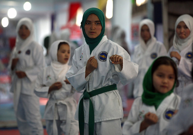 Afghan girls practice Taekwando, at a Gym in Kabul, Afghanistan, 25 June 2014. For nearly two decades during the Taliban rule in Afghanistan, sports and games including boxing, soccer, volleyball, kite flying and chess had been banned as immoral and unlawful. During the Taliban regime it was forbidden for women to participate in such sports and games. The Taliban's Islamist regime was toppled by a US-led campaign in late 2001. (Photo by Jawad Jalali/EPA)