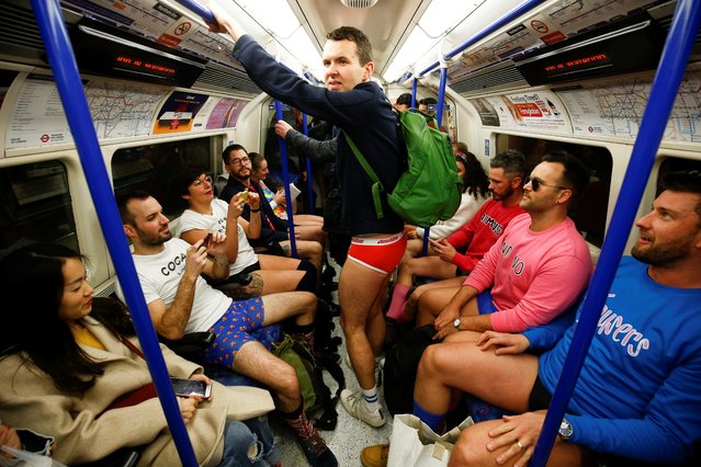 """People take part in the annual """"No Trousers Tube Ride"""" event in London, Britain, January 12, 2020. (Photo by Henry Nicholls/Reuters)"""