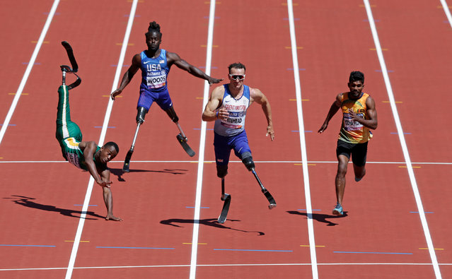 Richard Whitehead of Great Britain wins the Men's 100m T42 race, after Ntando Mahlangu of South Africa falls at the finish during the World Para Athletics Championships at London Stadium in Eats London, England on July 17, 2017. (Photo by Henry Browne/Reuters/Action Images)