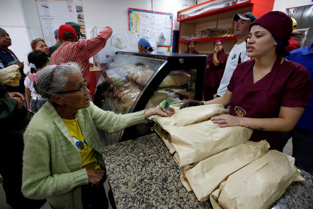 People buy bread at a state-run bakery in Caracas, Venezuela, June 25, 2016. (Photo by Marco Bello/Reuters)