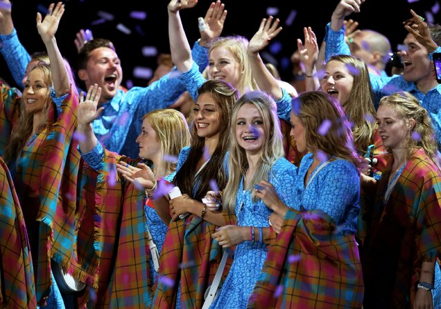 Athletes from Scotland soak up the atmopshere during the Opening Ceremony for the Glasgow 2014 Commonwealth Games at Celtic Park on July 23, 2014 in Glasgow, Scotland. (Photo by Chris Jackson/Getty Images)