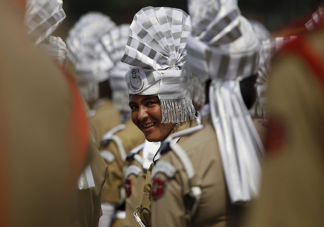 An Indian policewoman takes part in the full-dress rehearsal for India's Independence Day celebrations in Srinagar, August 13, 2015. (Photo by Danish Ismail/Reuters)
