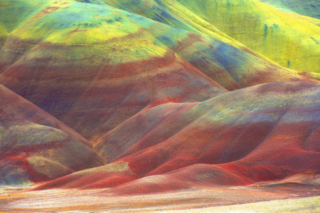 "Layers of breathtaking colour streak the rolling hills of this vast desert, making the landscape appear as though it has been tie-dyed. The natural phenomenon, nicknamed the ""Painted Desert"", was formed when the area was once a river floodplain. (Photo by Mark Brodkin/Solent News/SIPA Press)"