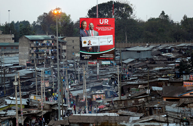 An election campaign billboard displaying Kenya's President Uhuru Kenyatta and Deputy President William Ruto is pictured in Mathare slum in Nairobi, Kenya August 10, 2017. (Photo by Thomas Mukoya/Reuters)