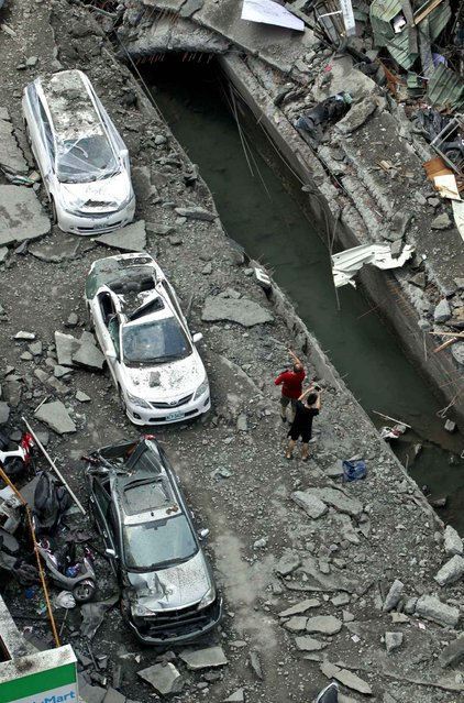 A rooftop view shows a street destroyed by a massive gas explosion in Kaohsiung, Taiwan, Friday, August 1, 2014. (Photo by Wally Santana/AP Photo)