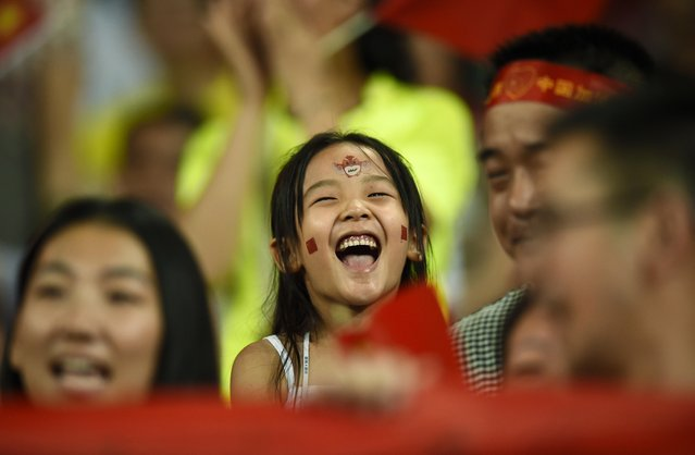 China fans cheer on their team at the 15th IAAF World Championships at the National Stadium in Beijing, China August 22, 2015. (Photo by Dylan Martinez/Reuters)