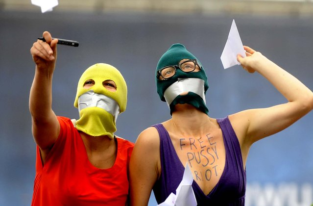Supporters of the Russian punk group p*ssy Riot walk through downtown Warsaw. (Photo by Alik Keplicz/Associated Press)