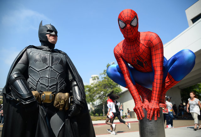 Dorian Black, left, dressed as Batman and Kyle Blankenfield as Spiderman on day 3 of Comic-Con International on Saturday, July 23, 2016, in San Diego. (Photo by Al Powers/Invision/AP Photo)