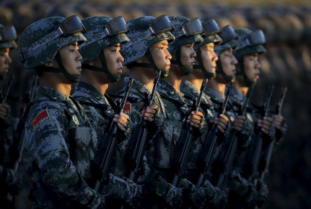 Soldiers of China's People Liberation Army (PLA) prepare in front of the Tiananmen Gate ahead of the military parade to mark the 70th anniversary of the end of World War Two, in Beijing, China, September 3, 2015. (Photo by Jason Lee/Reuters)