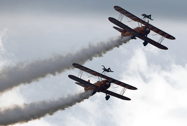 Breitling Wingwalker aircrafts perform during the Air14 airshow at the airport in Payerne August 31, 2014. (Photo by Denis Balibouse/Reuters)