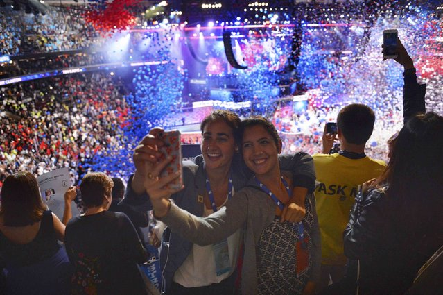 Delegates take a selfie during the balloon drop at the conclusion of the at the Democratic National Convention in Philadelphia, Pennsylvania. U.S. July 28, 2016. (Photo by Charles Mostoller/Reuters)