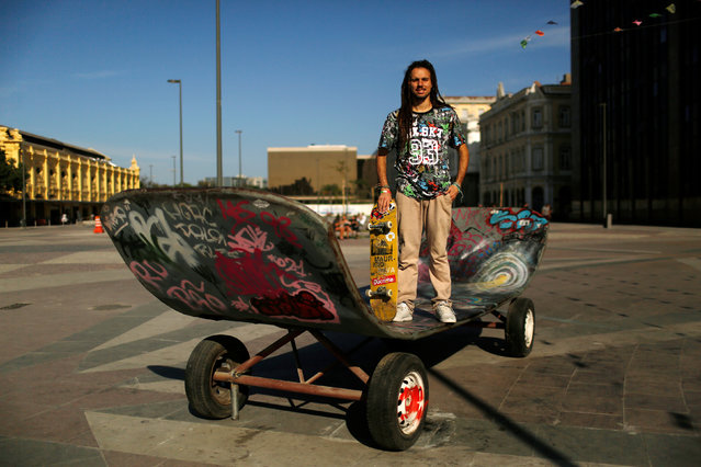 """Mauricio Nava, a 29-year-old skater, poses for a portrait in Rio de Janeiro, Brazil, July 9, 2016. Mauricio says, """"There are visible improvements in the city such as to public transport and recreational spaces, if it wasn't for the Olympics, Cariocas (locals) would not have benefited"""". (Photo by Pilar Olivares/Reuters)"""