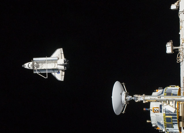 The space shuttle Discovery after it undocked from the International Space Station, in a photo taken more than 200 miles above Earth and released on March 9, 2011. (Photo by Reuters/NASA)