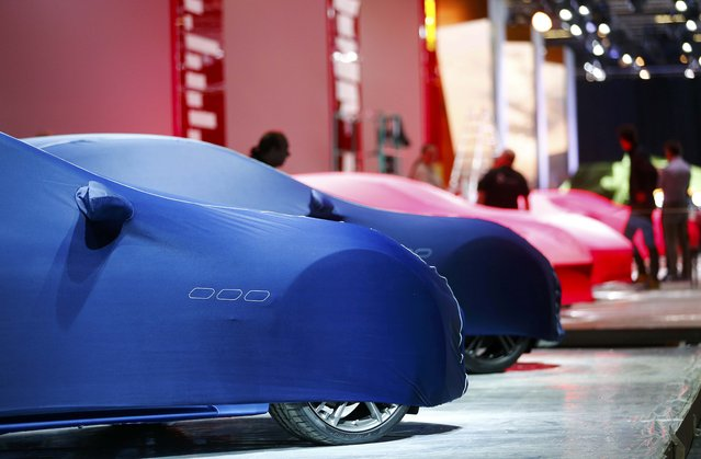 Covered Maseratis (blue) and Ferraris are pictured during the media day at the Frankfurt Motor Show (IAA) in Frankfurt, Germany, September 14, 2015. (Photo by Kai Pfaffenbach/Reuters)