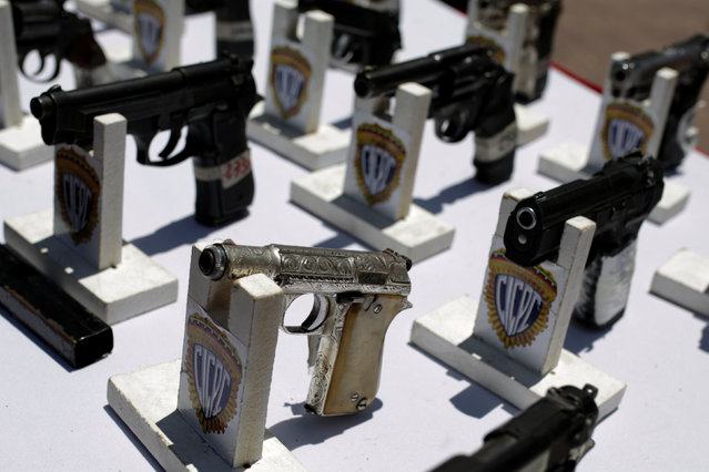 Seized weapons are displayed before being destroyed during an exercise to disable confiscated weapons, in Caracas, Venezuela, August 17, 2016. (Photo by Marco Bello/Reuters)