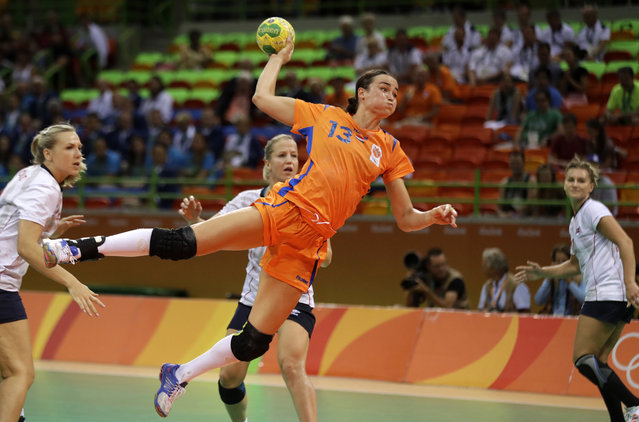 Netherlands' Yvette Broch scores a goal past the Norwegian defence during the women's bronze medal handball match between Norway and Netherlands at the 2016 Summer Olympics in Rio de Janeiro, Brazil, Saturday, August 20, 2016. (Photo by Ben Curtis/AP Photo)