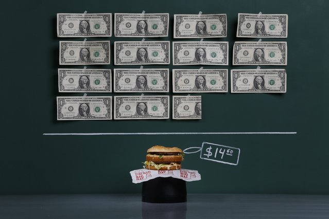 A Big Mac as photographed in a studio with an illustrative price tag of $14.60 (US dollars), equivalent to the Bs. 92 (bolivars) that it costs on average to purchase in Caracas at the official exchange rate of 6.3 bolivars per dollar, in Caracas September 29, 2014. (Photo by Carlos Garcia Rawlins/Reuters)