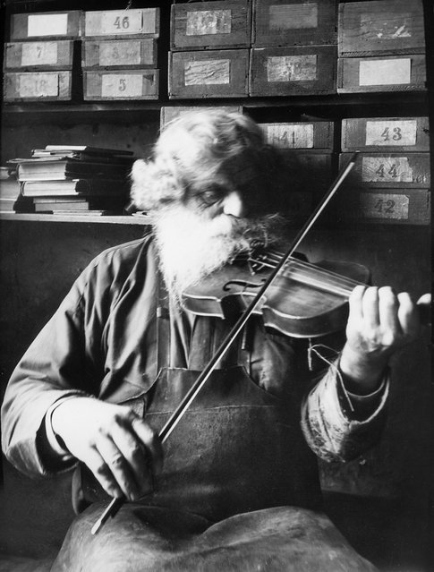 Petrus Norling, Knivsta, Uppland, Sweden, 1938. The shoemaker, woodcarver and fiddler Petrus Norling in Knivsta, playing the violin. Born in 1869. (Photo by Einar Erici)