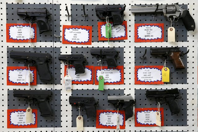 """Guns for sale are displayed in Roseburg Gun Shop in Roseburg, Oregon, United States, October 3, 2015. Christopher Harper-Mercer, the gunman slain by police after he killed his English professor and eight others at an Oregon college, was once turned away from a firearms academy by an instructor who recalled finding him """"weird"""" and """"a little bit too anxious"""" for high-level weapons training. (Photo by Lucy Nicholson/Reuters)"""