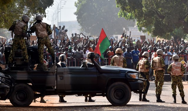 Troops face protestors on October 30, 2014 in Ouagadougou. (Photo by Issouf Sanogo/AFP Photo)