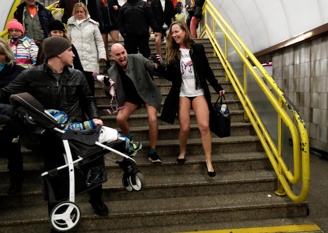 Passengers not wearing pants walk down the stairs during an annual flash mob event called the No Pants Subway Ride in Prague, Czech Republic on January 7, 2018. (Photo by David W. Cerny/Reuters)