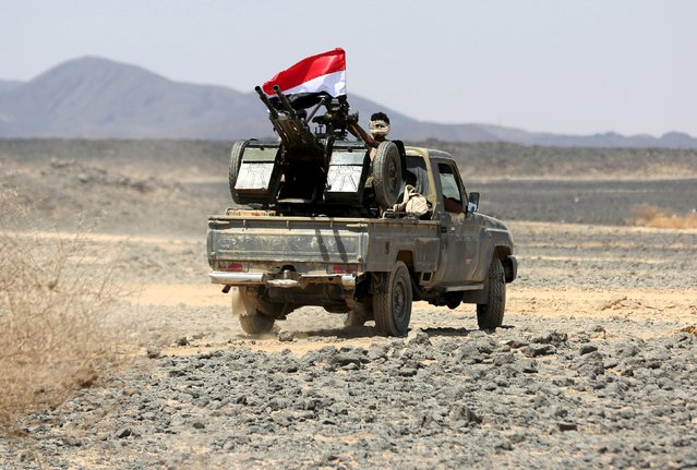 A tribal fighter loyal to Yemen's government rides a truck at the frontline of fighting against Houthi militants in the central province of Marib October 7, 2015. (Photo by Reuters/Stringer)