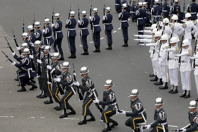 Military honour guards take part in Taiwan's National Day celebrations in front of the presidential office in Taipei, Taiwan, October 10, 2015. (Photo by Pichi Chuang/Reuters)