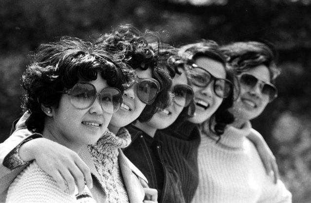 Women wearing sunglasses pose for a group photo at a park in Beijing in 1980. (Photo by Reuters/China Daily)
