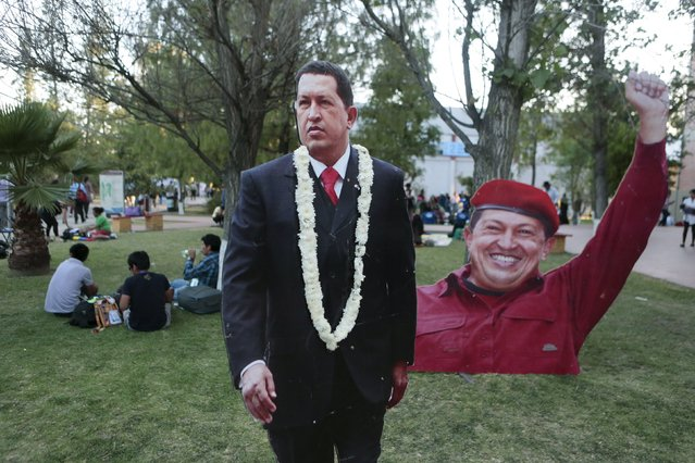 Images of Venezuela's late President Hugo Chavez are displayed outside of the World People's Conference on Climate Change and the Defense of Life, ahead of next month's World Climate Change Conference in France, in Tiquipaya, Bolivia, October 10, 2015. (Photo by David Mercado/Reuters)