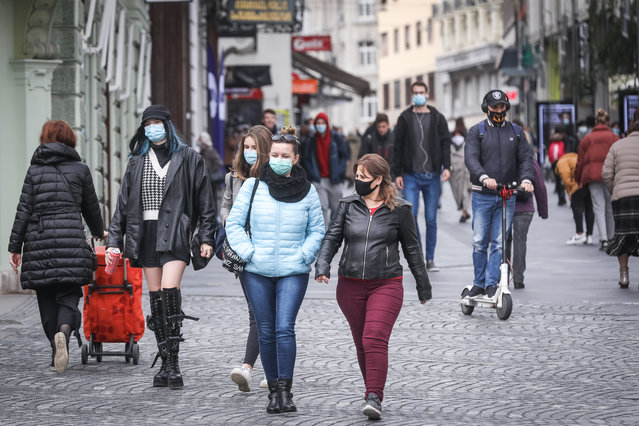 People wearing masks are seen outside as the government enacted a ban on non-essential travels in seven red-listed regions with declaring additional restrictive measures to contain the spread of coronavirus (Covid-19) in Ljubljana, Slovenia on October 16, 2020. These seven regions are the Central Slovenia, Gorenjska, Koroska, Zasavje, Posavje, Savinjska and South-eastern Slovenia. Face masks will also be mandatory outdoors as well as indoors in red regions. These additional measures will be controlled by official authorities and fines will be imposed in case of violations. (Photo by Ales Beno/Anadolu Agency via Getty Images)