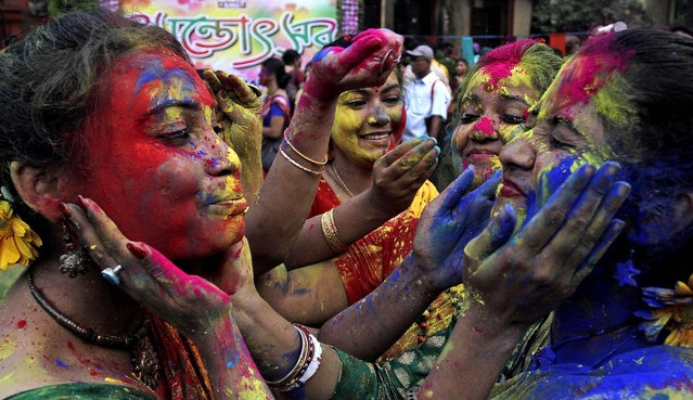 Students smear each other's faces with colored powder as they celebrate Holi at the Rabindra Bharati University campus in Kolkata, India on Friday, on March 22, 2013. (Photo by Bikas Das/Associated Press)