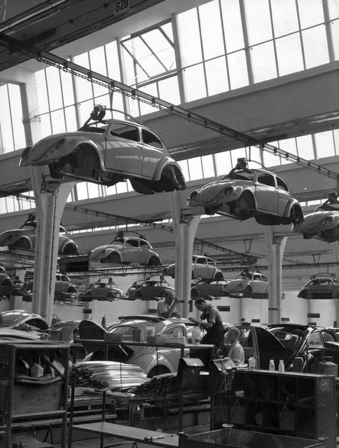 Workers on the production line of a Volkswagen factory at work on Beetles, circa 1955. (Photo by Keystone/Getty Images)