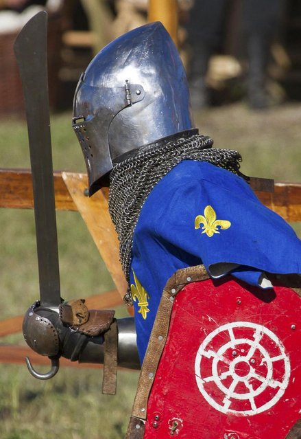 """A French contestant runs during the """"Battle of Nations"""" in Aigues-Mortes, southern France, Friday, May 10, 2013 where Middle Ages fans attend the historical medieval battle  competition. The championship will be attended by 22 national teams, which is twice the number it was last year. The battle lasts until May 12. (Photo by Philippe Farjon/AP Photo)"""