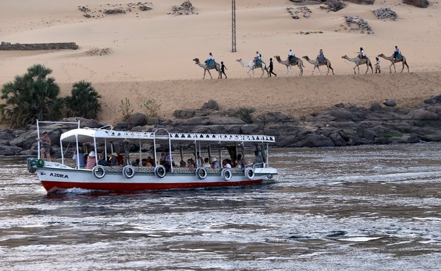 Tourists ride in a Falluka (small boat) along the Nile river in Aswan on the road to the touristic Nubia, south of Egypt, October 1, 2015. (Photo by Mohamed Abd El Ghany/Reuters)